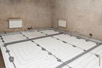 Фото матов Пенощит WF16-50 и контуров труб «теплого пола» в одном из помещений подвального этажа