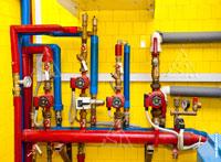 Фото установленных насосов Grundfos в гребенке отопления